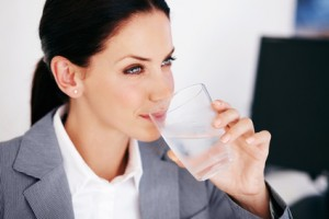 Executive woman drinking water